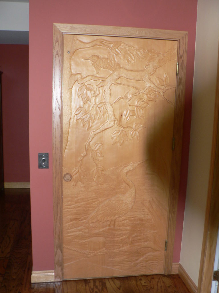 Carved Elevator Door by First Nations 11046 Chalet Rd, Deep Cove